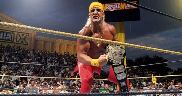 Hulk Hogan in the ring pointing to the title belt after lifting the belt off of Bret Hart vs. Yokozuna at WrestleMania 9