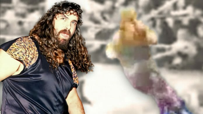 In a frightening moment, Mick Foley gets caught up in the ropes in a match against Vader in Germany in 1994. Moments later, he would lose his ear.