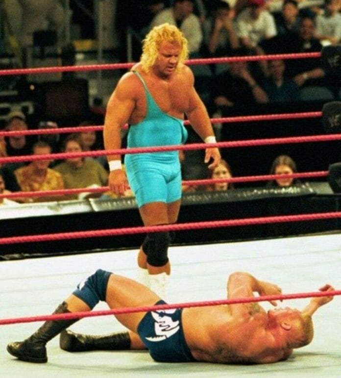 Curt Hennig wrestling against Brock Lesnar in 2002. A mid-air tussle between the two of them ultimately led to the end of Mr. Perfect's time in WWE