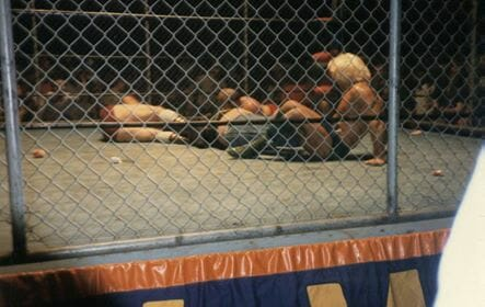 Photo courtesy of reader Mike Holcomb ofWinterville, Georgia, who was front row ringside that night. He managed to snap this photo usinga pocket Instamatic. Hehad to bail from ringside as it was becoming a full-blown straight-up riot scene! Mike also describes that the Atlanta police were peeling fans off the cage who were trying to climb in and help Dusty. Flair wrote in his book that this night was the most heat he'd ever generated in an arena.