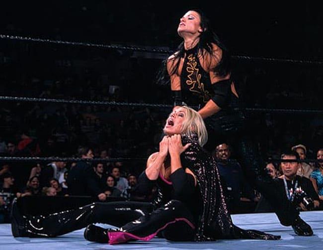 Lisa Marie Varon playing rough by choking Trish Stratus in their hardcore match at Survivor Series, 2002.
