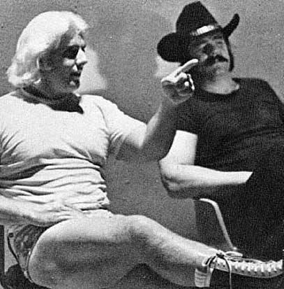 Ric Flair and Blackjack Mulligan sitting backstage talking