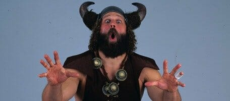 The Berzerker promo photo wearing a viking helmet making a scary face