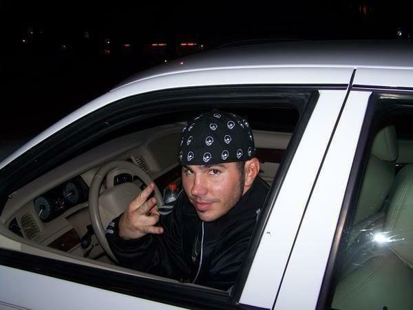 Matt Hardy looking out the window of a car