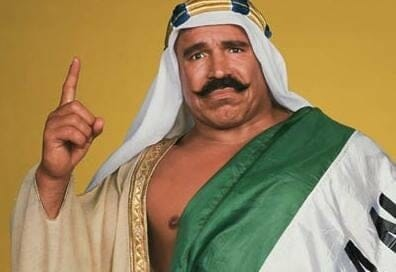 The Iron Sheik in costume showing he's #1 with his pointer finger