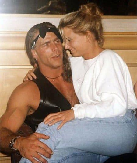 The 'Kliq Chick' Sunny sitting in Shawn Michaels lap