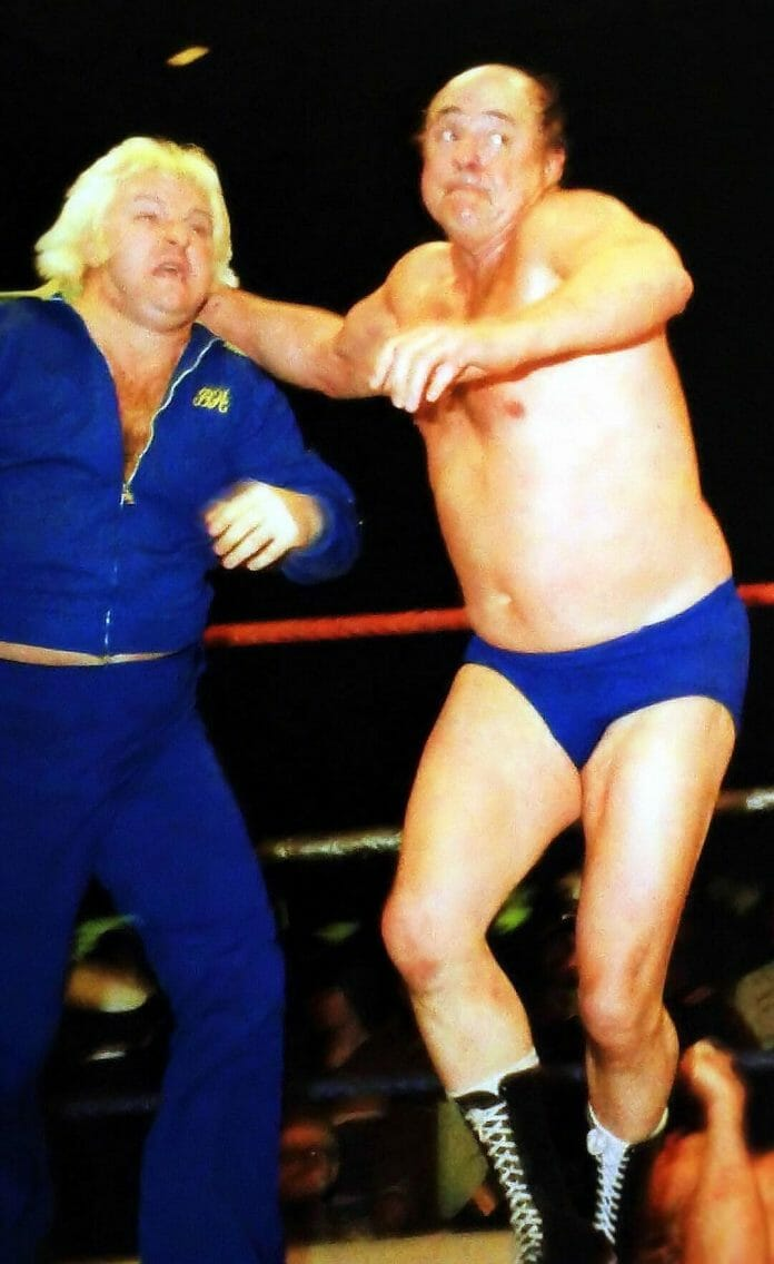 """Verne Gagne had many in-ring run-ins with """"The Brain."""" Here, he prepares to toss Bobby Heenan out of the ring."""