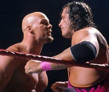 Steve Austin and Bret Hart in each others faces in the ring