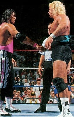 Bret Hart and 'Mr Perfect' Curt Hennig shaking hands in the ring
