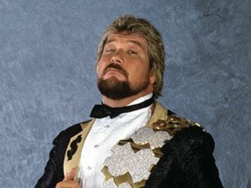 Ted Dibiase in his tuxedo with gold and dollar sign lapels