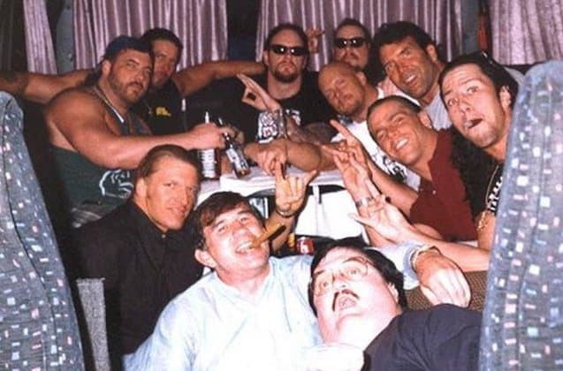 Wrestlers together on a European tour bus from left to right: Henry Godwinn, Kevin Nash, Triple H, Gerald Brisco, Undertaker, Phineas Godwinn/Mideon, Steve Austin, Scott Hall, Shawn Michaels, Sean Waltman and Paul Bearer up front