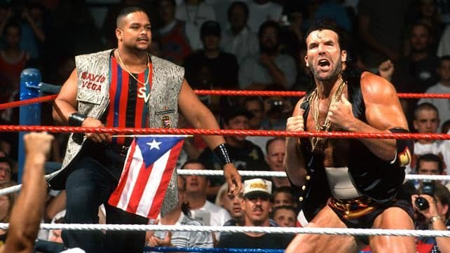 Savio Vega and Scott 'Razor Ramon' Hall in the ring before a match