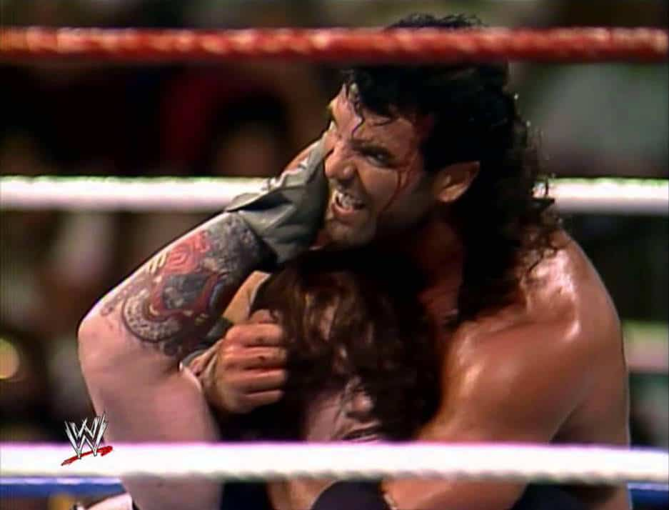 Razor Ramon putting locking a hold on The Undertaker