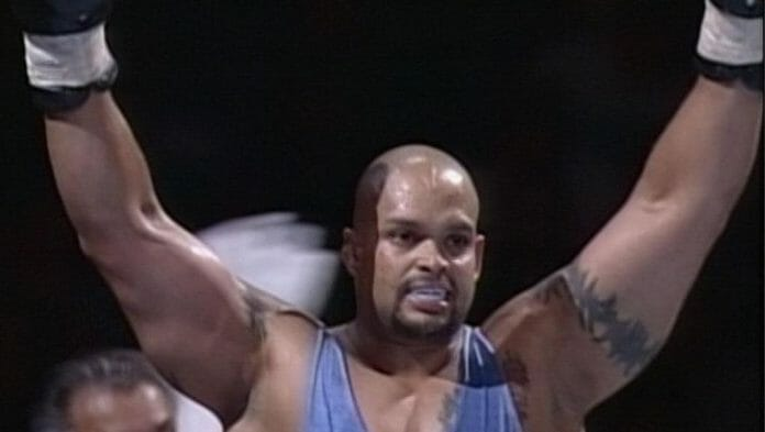 Savio Vega with his hands in the air claiming victory - Savio Vega sounds off on WWE's The Kliq, why he was let go and if they were responsible. See who you believe.