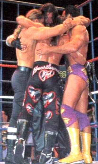 WWE's The Kliq hugging after their last tag team cage match ruining Kayfabe forever
