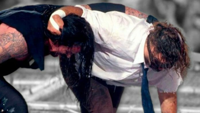 Undertaker and Mick Foley battle it out atop the Hell in a Cell moments before all hell breaks loose.