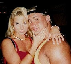 Tammy Sytch and Chris Candido posing together with her holding his chin
