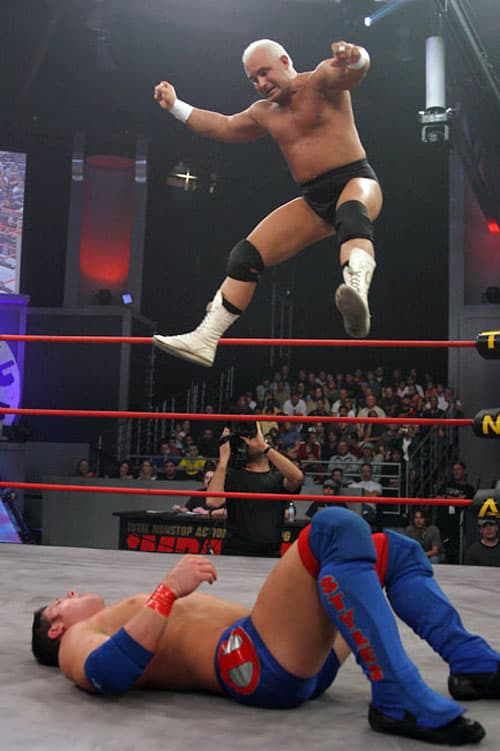 Chris Candido laying the stomp down on AJ Styles. Candido found a new-found hunger for professional wrestling in TNA.