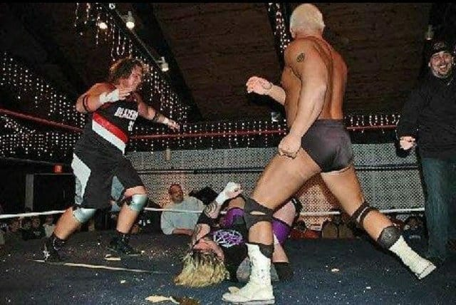 Brothers Jonny and Chris Candido putting the boots to Balls Mahoney in 2005.