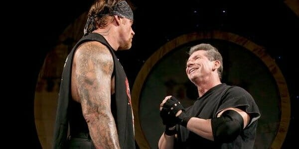 The Undertaker talking with Vince McMahon