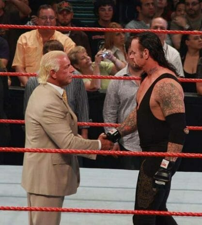 Ric Flair and The Undertaker shaking hands in the ring.