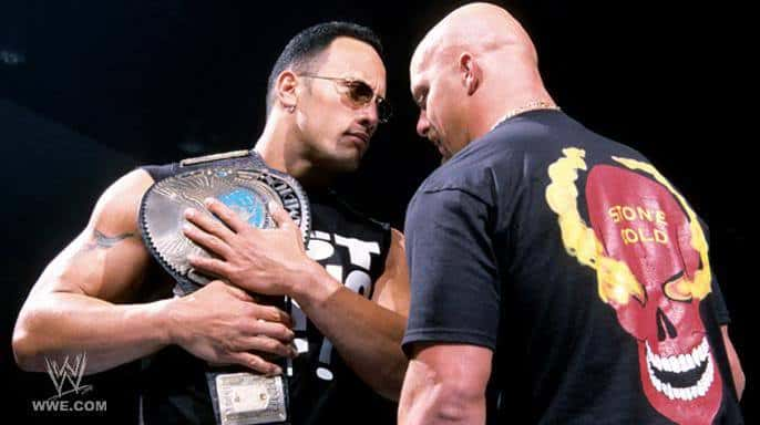 Holding the Title The Rock and Stone Cold face off in the ring