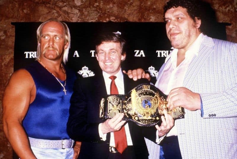 """Donald Trump holding the title belt with Andre the Giant alongside Hulk Hogan promoting their championship match before WrestleMania IV, which took place at the Historic Atlantic City Convention Hall (aka """"Trump Plaza"""") in Atlantic City, New Jersey."""