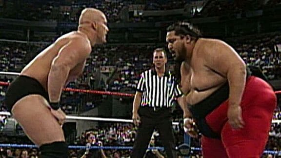 Yokozuna facing off with Steve Austin in the ring