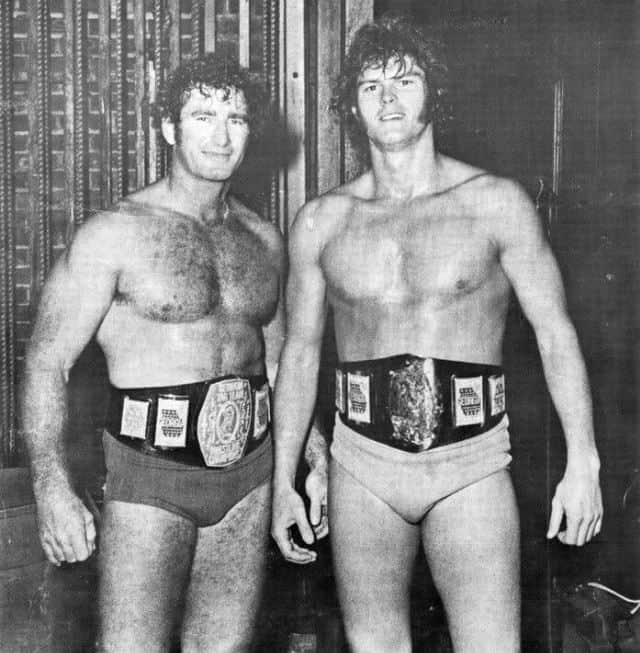 Bob Armstrong and Ron Fuller before going into business together in Southeastern Wrestling holding the Georgia tag team titles.