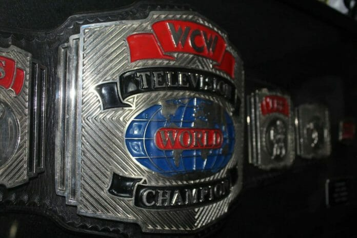 The first WCW TV Title Belt made of black leather with silver, black, and red metal