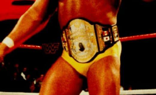 Hulk hogan in a black and gold title belt