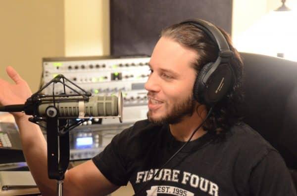 Bryan Alvarez, co-host of Wrestling Observer Radio on the microphone in his studio