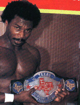 Brickhouse Brown holding up the Texas Heavyweight Wrestling Championship