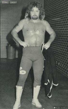 """Loverboy"" Dennis Condrey in wrestling tights and hands on his hips before a match"