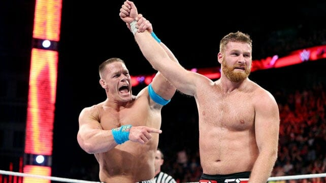 John Cena Holding Up the arm of Sami Zayn in the ring