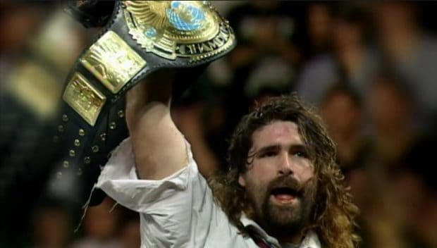 Photo of Mick Foley holding title belt from wrestling book Have A Nice Day The Tale of Blood and Sweatsocks