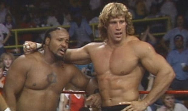 Iceman King Parsons and Kerry Von Erich looking out of breath during a televised show broadcast from the Sportatorium in Dallas, Texas.