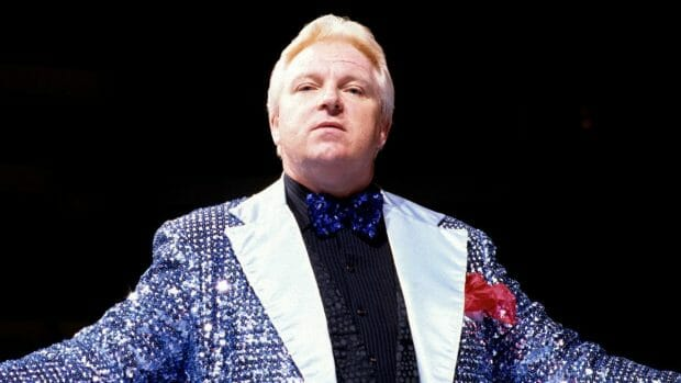 Bobby The Brain Heenan the Greatest of all Wrestling Managers in a Purple Sequined Tux Jacket, black shirt and purple bow tie