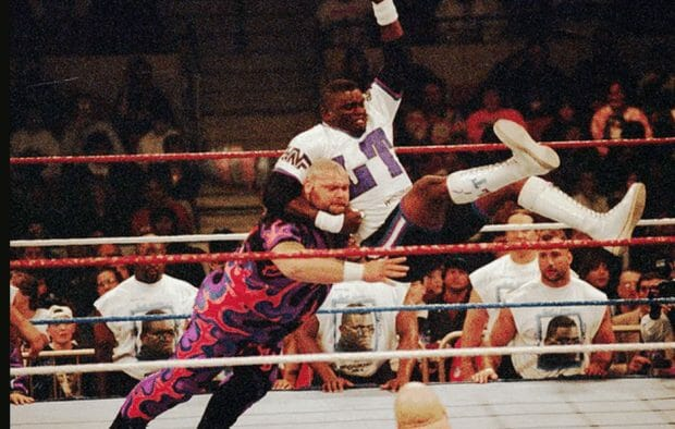 NFL Hall-of-Famer Lawrence Taylor gives Bam Bam Bigelow a bulldog in the main event of WrestleMania XI.