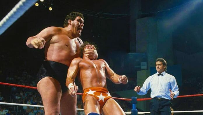 Andre the Giant about to strike Randy Savage in the wrestling ring with a referee looking on