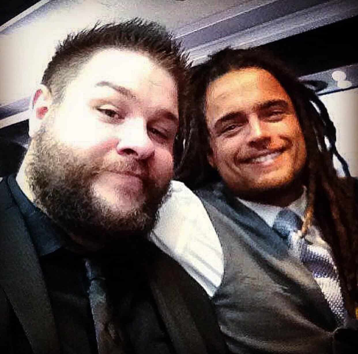 Kevin Owens and Juice Robinson take a selfie on an airplane