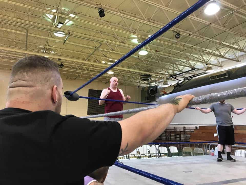 Johnny Kaos listens as Brutal Bob Evans explains what he expects from attendees to his seminar in Munford, Alabama.