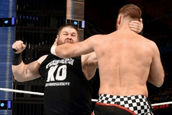 Kevin Owens and Sami Zayn wrestling each other in the ring