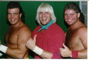 Johnny, Tommy, and Davy Rich facing left in a row with their thumbs up