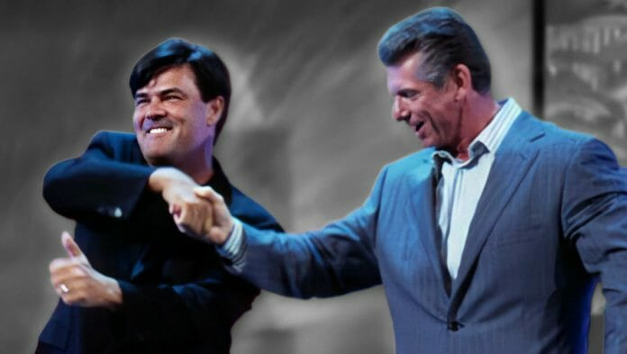 Vince McMahon and Eric Bischoff shaking hands during Bischoff's WWE debut.