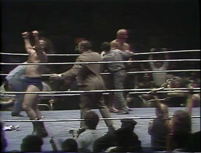 Bruno Sammartino celebrating after the ref stops the match at Madison Square Garden after Superstar Billy Graham's face is covered in blood