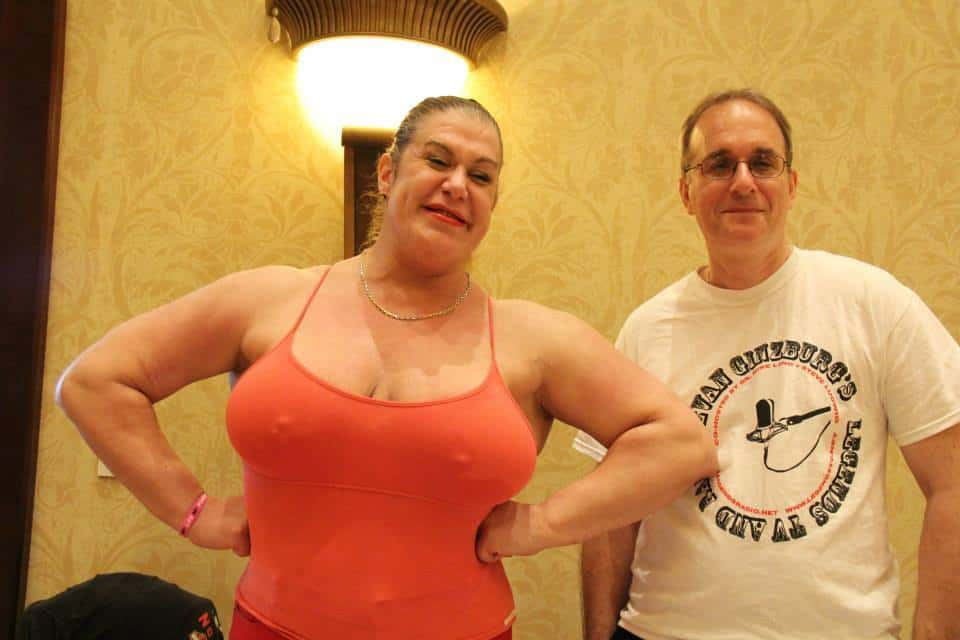Nicole Bass and Author Evan Ginzburg in 2016 Nicole wearing a red tank top and even in a tshirt