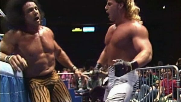 Shawn Michaels battling 'Superfly' Jimmy Snuka in 1992 on the floor outside the ring