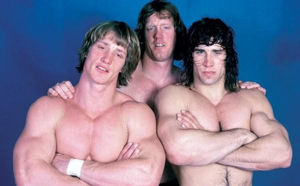 Brothers Kevin, David, and Kerry Von Erich posing together with arms crossed and no shirt