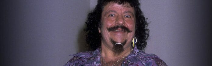 Lou Albano smiling with his signature rubber band on his chin